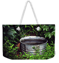 Weekender Tote Bag featuring the photograph Water Bearer by Jessica Brawley