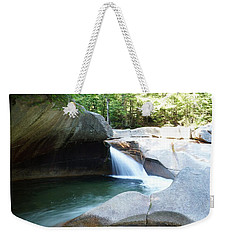 Weekender Tote Bag featuring the photograph Water-carved Rock by Kerri Mortenson
