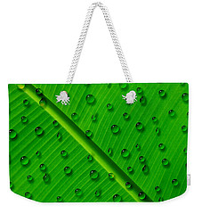 Water Drops On Palm Leaf Weekender Tote Bag by Georgeta Blanaru