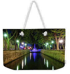 Weekender Tote Bag featuring the photograph Water Fountain At Night by Scott Carruthers