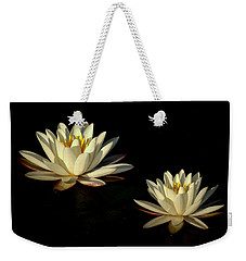 Weekender Tote Bag featuring the photograph Water Lilies by Beth Vincent