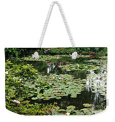 Weekender Tote Bag featuring the photograph Waterlilies At Monet's Gardens Giverny by Therese Alcorn