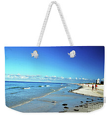 Weekender Tote Bag featuring the photograph Water's Edge by Gary Wonning