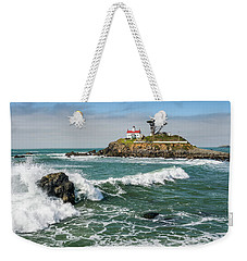 Weekender Tote Bag featuring the photograph Wave Break And The Lighthouse by Greg Nyquist