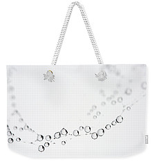 Weekender Tote Bag featuring the photograph Web Water Baubles by Rebecca Cozart