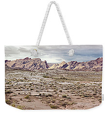 Weekender Tote Bag featuring the photograph Weird Rock Formation by Peter J Sucy
