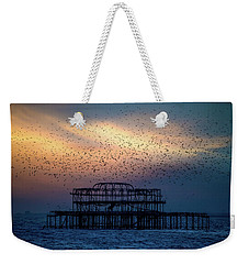 Weekender Tote Bag featuring the photograph West Pier Murmuration by Chris Lord
