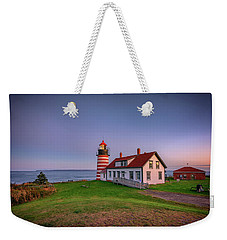 Weekender Tote Bag featuring the photograph West Quoddy Head Light At Dusk by Rick Berk