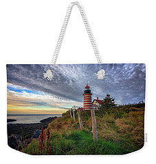 Weekender Tote Bag featuring the photograph West Quoddy Head Light Station by Rick Berk