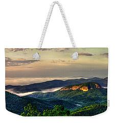 Weekender Tote Bag featuring the photograph Looking Glass Rock Sunrise Between The Clouds Blue Ridge Parkway by Reid Callaway