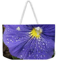Weekender Tote Bag featuring the photograph Wet Pansy by Jean Noren