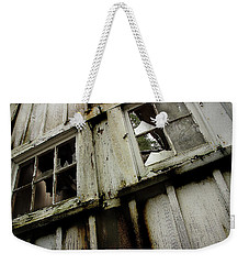 Weekender Tote Bag featuring the photograph What Lies Within by Mike Eingle