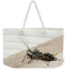 Weekender Tote Bag featuring the photograph Wheel Bug With Prey by Kristin Elmquist