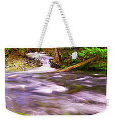 Weekender Tote Bag featuring the photograph Where The Stream Meets The River by Jeff Swan