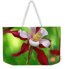 Weekender Tote Bag featuring the photograph White And Red Columbine  by James Steele