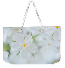 Weekender Tote Bag featuring the photograph White Beauty by Leland D Howard