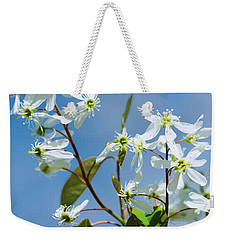 Weekender Tote Bag featuring the photograph White Blossom by Cristina Stefan