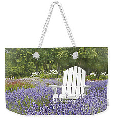Weekender Tote Bag featuring the photograph White Chair In A Field Of Lavender Flowers by Brooke T Ryan