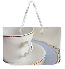 Weekender Tote Bag featuring the photograph White China Cup, Saucer And Plates by Lyn Randle