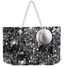 Weekender Tote Bag featuring the photograph White Christmas Bauble  by Ulrich Schade