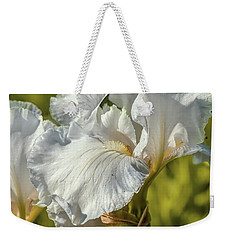Weekender Tote Bag featuring the photograph White Iris June 2016.  by Leif Sohlman