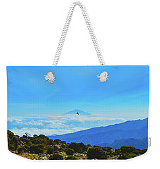 Weekender Tote Bag featuring the photograph White-necked Raven Soaring Above Mount Kilimanjaro With Mount Meru by Jeff at JSJ Photography