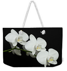 Weekender Tote Bag featuring the photograph White On Black by Denise Bird