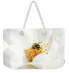 Weekender Tote Bag featuring the photograph Looking For Gold In A White Rose by Mariella Wassing