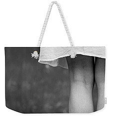 Weekender Tote Bag featuring the photograph White Shirt by Andrey  Godyaykin