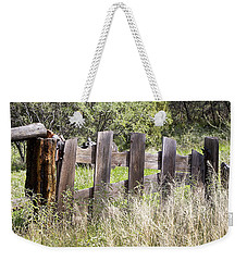Weekender Tote Bag featuring the photograph Who Ate The Fence by Phyllis Denton