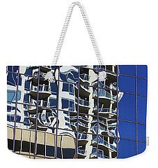 Weekender Tote Bag featuring the photograph Wiggly Balconies by Phyllis Denton