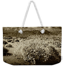 Weekender Tote Bag featuring the photograph Wild Desert Flowers Blooming In Sepia Tone  by Randall Nyhof