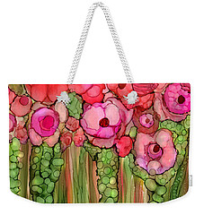 Weekender Tote Bag featuring the mixed media Wild Poppy Garden - Pink by Carol Cavalaris