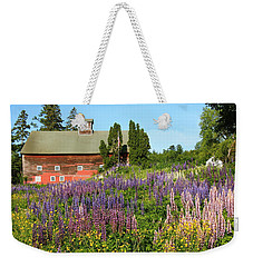 Weekender Tote Bag featuring the photograph Wildflowers And Red Barn by Roupen  Baker