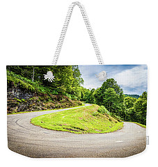 Weekender Tote Bag featuring the photograph Winding Road With Sharp Curve Going Up The Mountain by Semmick Photo