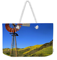 Weekender Tote Bag featuring the photograph Windmill by Henrik Lehnerer