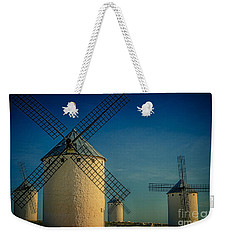 Weekender Tote Bag featuring the photograph Windmills Under Blue Sky by Heiko Koehrer-Wagner