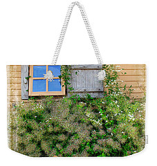 Weekender Tote Bag featuring the photograph Window Floral In Plymouth by Joan  Minchak