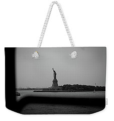 Weekender Tote Bag featuring the photograph Window To Liberty by David Sutton