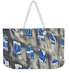 Weekender Tote Bag featuring the photograph Windows Of 2 World Financial Center 3 by Sarah Loft