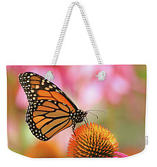 Weekender Tote Bag featuring the photograph Winged Beauty by Doris Potter