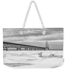 Weekender Tote Bag featuring the photograph Winter At Mackinac Bridge by John McGraw