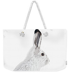 Weekender Tote Bag featuring the photograph  Winter Snowshoe Hare by Jennie Marie Schell