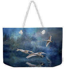 Weekender Tote Bag featuring the photograph Winter Swans by Brian Tarr