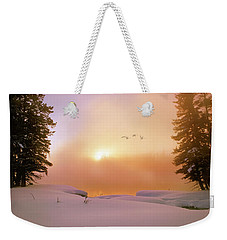 Weekender Tote Bag featuring the photograph Winter Swans by Leland D Howard