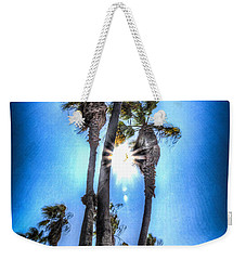 Weekender Tote Bag featuring the photograph Wispy Palms by T Brian Jones