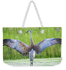 Weekender Tote Bag featuring the photograph With Open Arms by Steven Santamour