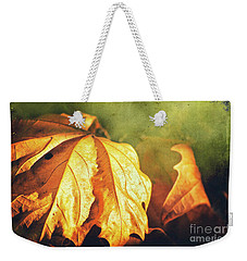 Weekender Tote Bag featuring the photograph Withered Leaves by Silvia Ganora