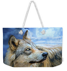 Weekender Tote Bag featuring the mixed media Wolf Glow by Carol Cavalaris