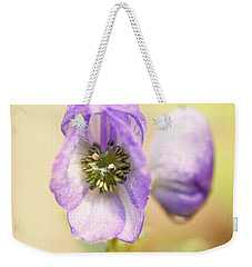 Weekender Tote Bag featuring the photograph Wolf's Bane Flower With Pistils by Nick Biemans